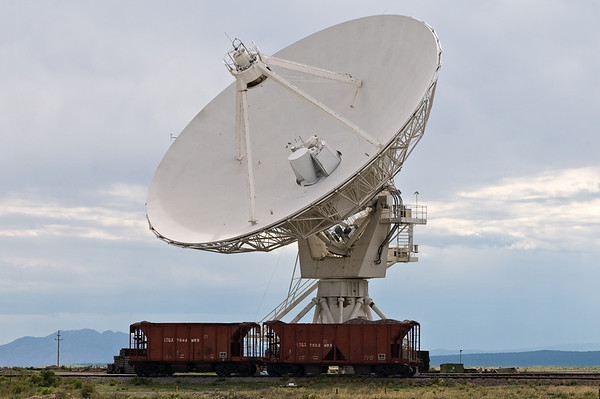 One of the 230-ton, 28-meter diameter VLA radio telescopes. Note the railroad cars for scale.