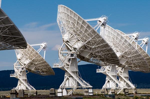 A row of VLA radio telescopes.